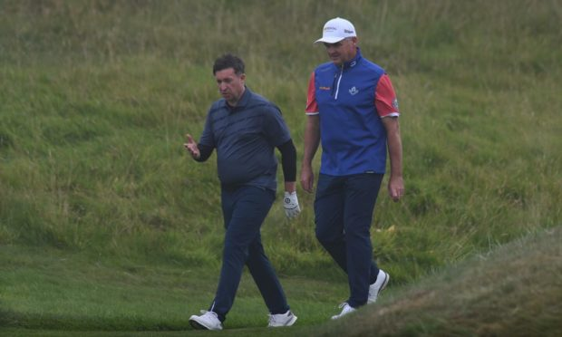 Paul Lawrie chats with Robbie Fowler during the Celebrity Pro-Am