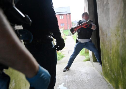 A series of raids were carried out in Fraserburgh on Tuesday. Picture by KATH FLANNERY
