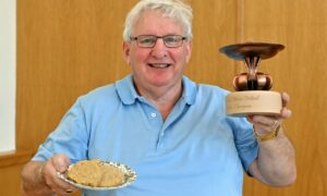 Johnnie Wiseman with his winning trophy for the traditional oatcake category..