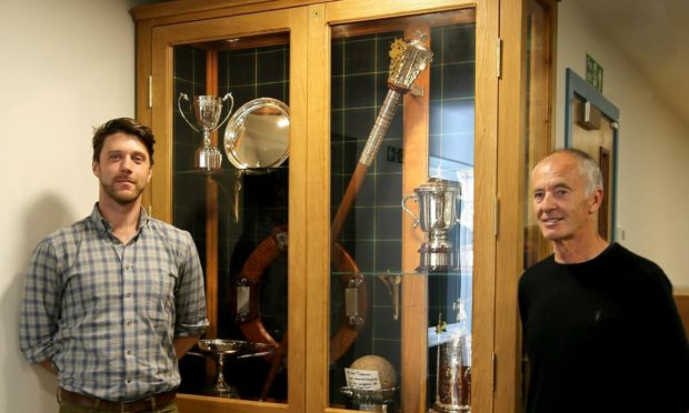 Pictured (L-R) are Lewis Lilburn and Aboyne Highland Games chairman Alistair Grant beside the new trophy cabinet.