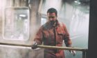 Martin Compston's character working on an oil rig in Amazon's thriller The Rig.