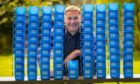 Mary's Meals founder Magnus MacFarlane Barrow with the mugs that serve the meals