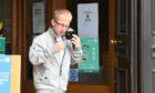 Calum Robertson leaving Aberdeen Sheriff Court.