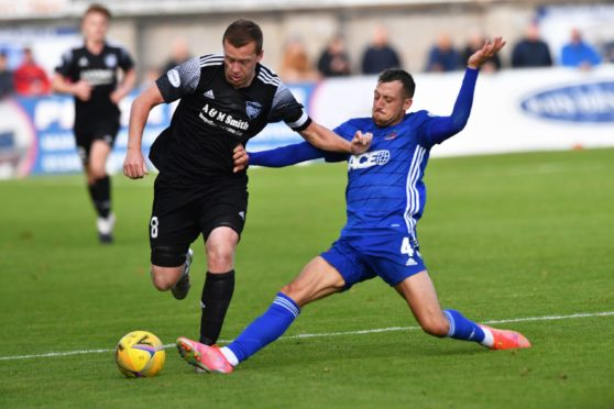 Cove Rangers' Connor Scully tackles Peterhead captain Scott Brown.