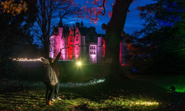 Pictures by JASON HEDGES     04.11.2020 URN: CRO24851 Brodie Castle is lit up with a light show on the castle and grounds to generate extra income over Winter and through the covid period. Picture: Steven George and Leanne Murphy from Elgin are pictured Pictures by JASON HEDGES