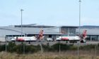 Planes on the ground at Inverness Airport. Photo: Sandy McCook/DCT Media