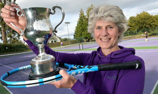 Joanie Whiteford won her 25th singles title as well as the mixed and ladies doubles