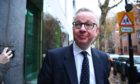 Michael Gove arrives at his office in Westminster, London.