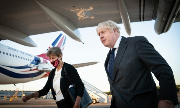 Prime Minister Boris Johnson with Dame Barbara Janet Woodward, Permanent Representative of the United Kingdom to the United Nations as he lands in New York's JFK airport for a diplomatic trip to the United States. Picture by PA.