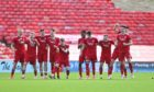 The Aberdeen players celebrate their penalty shootout win against Arbroath.