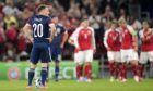 Scotland's Ryan Fraser looks dejected after they concede the first goal against Denmark.