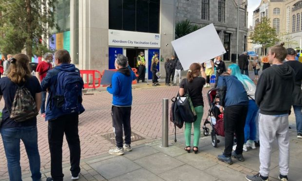 Anti-vaccination protesters outside the former John Lewis in Aberdeen.