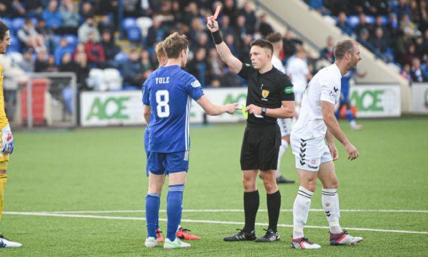 Referee Matthew MacDermid sends off Cove Rangers midfielder Blair Yule.