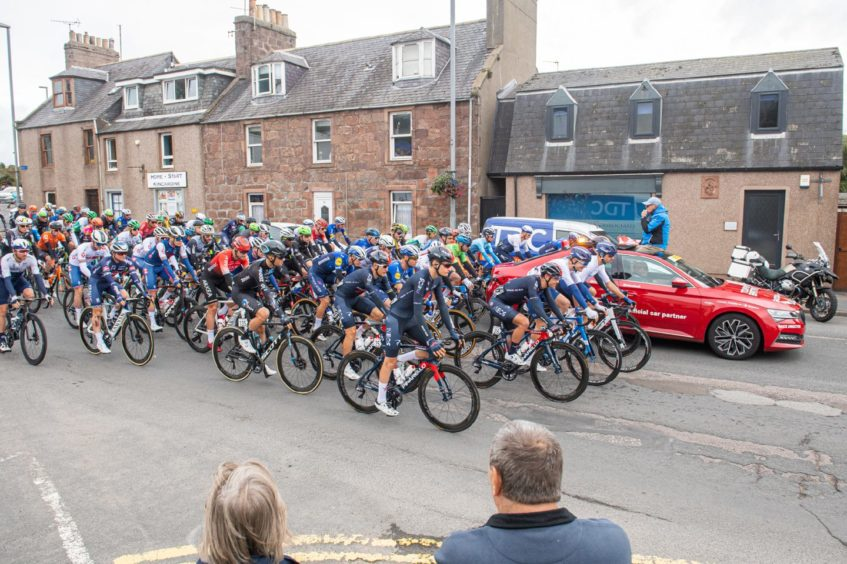 The cyclist procession heads through Stonehaven streets.