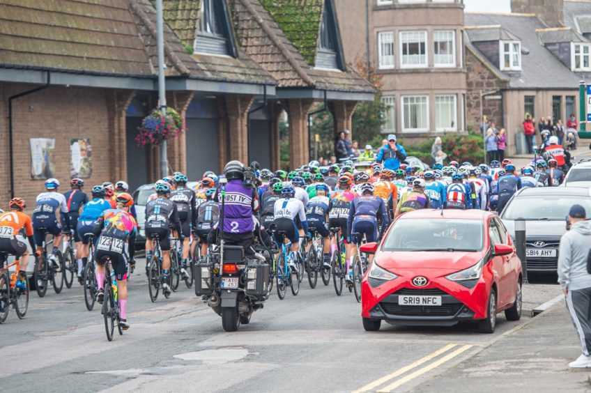 Participants cross the starting line in Stonehaven.
