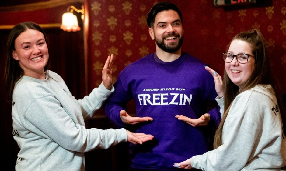 Freezin cast members, Amy Lamb, Michael Innes and Erin Chalmers, can't wait to get on the HMT stage. Photo Credit Wullie Marr