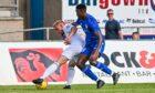 Peterhead defender Jadel Musanhu, right, in debut action against Cove Rangers in July.