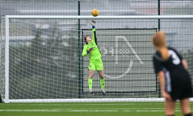 Gail Gilmour tips a shot over the bar.