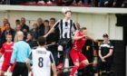 Sean Butcher, second from right, winning a header for Fraserburgh