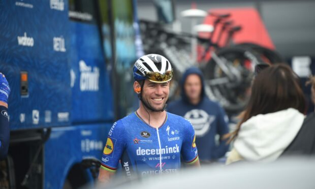 Mark Cavendish signed autographs as he was wished good luck by his daughter ahead of commencing the final leg of the Tour of Britain.