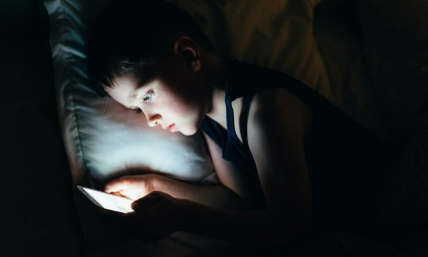Children use many apps every day to socialise and play games (Photo: Daniel Jedzura/Shutterstock)