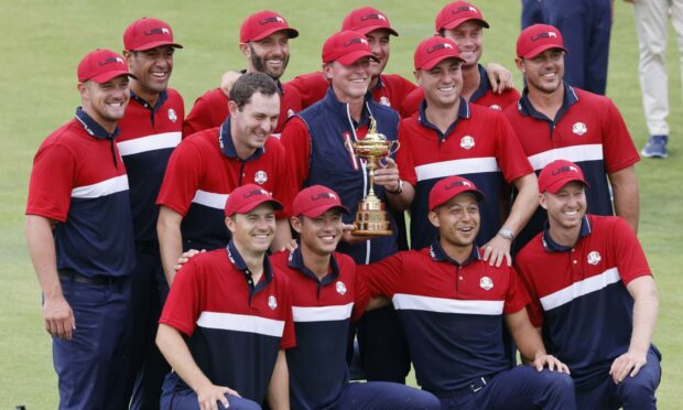 The US Ryder Cup team with their prize.
