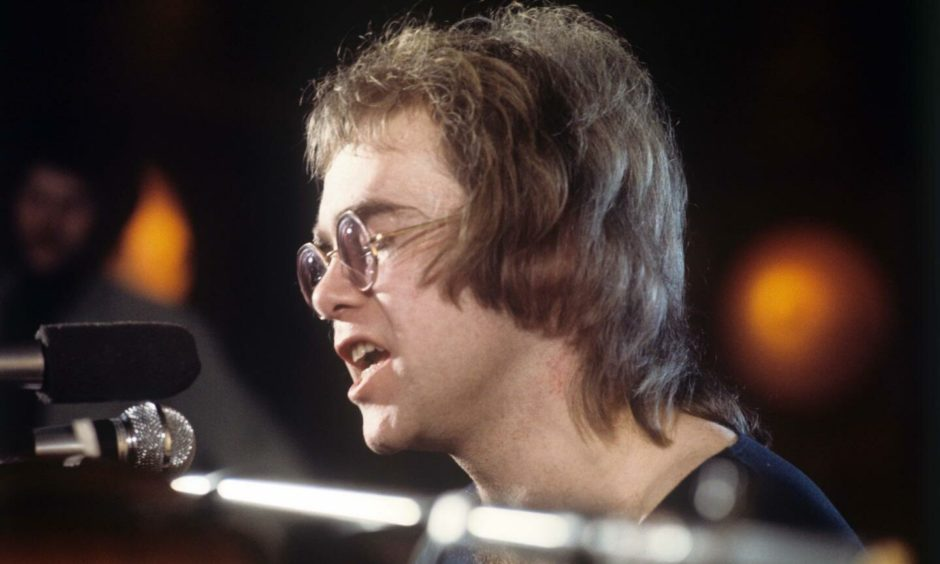 Sir Elton John performing in 1971.