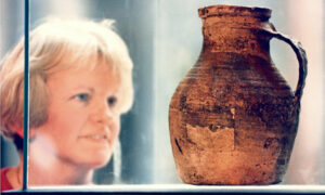1996 - Keeper of archaeology Judith Stones examines the King Street Pot, which dates from the mid-13th century, and was on display in the centre court at Aberdeen Art Gallery
