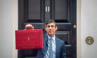 Chancellor of the Exchequer, Rishi Sunak outside 11 Downing Street, London, before heading to the House of Commons to deliver his Budget.