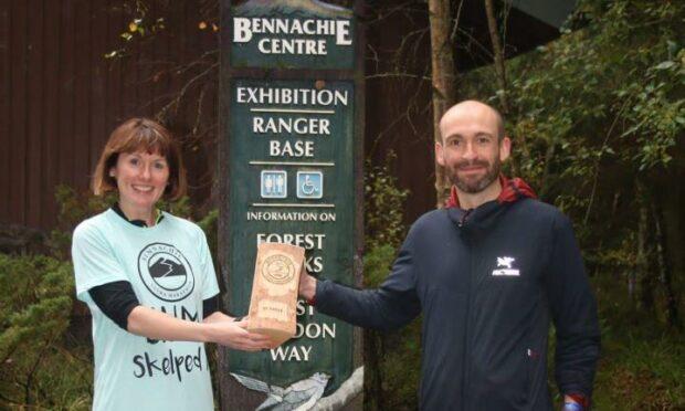 Allan Christie, right, with race sponsor Karen Simpson (Peterkins) at the Bennachie Ultra 2021.