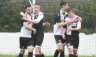 Sunnybank's Dean Still, far left, is congratulated by Jack Craigie after scoring the opening goal.