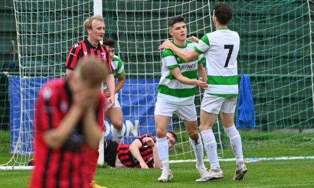 Buckie celebrate doubling their advantage through Craig Gill's own goal.