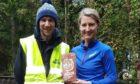 Jana Vidis, Bennachie ultra 2021 winner, pictured with race organiser Andrew Gordon.