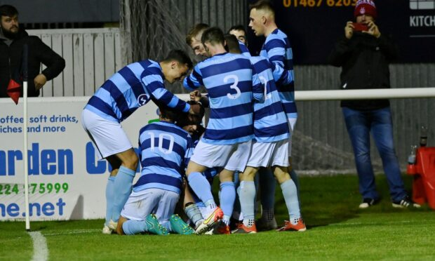The Banks o' Dee players celebrate Mark Gilmour's opener in the Evening Express Aberdeenshire Cup final against Formartine