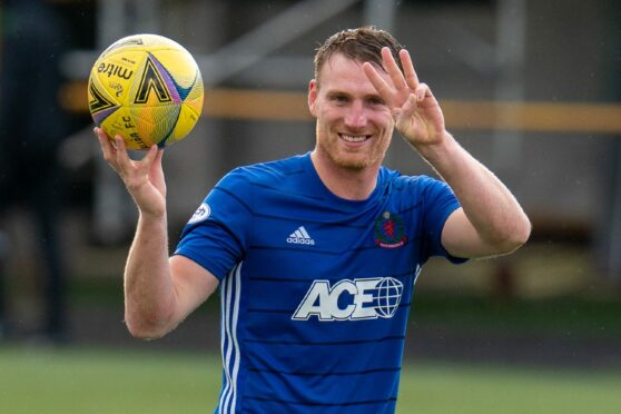 Cove Rangers forward Rory McAllister celebrates with the match ball.