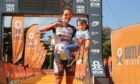 Metro Aberdeen's Debbie Greig finishing the Outlaw X triathlon with eldest son Logan. Debbie was competing weeks after giving birth to her second son Lennox and has been nominated for the Inspiration Award at Aberdeen's Sports Awards 2022. Picture shows; Metro Aberdeen's Debbie Greig finishing the Outlaw X triathlon with eldest son Logan. Debbie was competing weeks after giving birth to her second son Lennox.