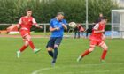 Keir Smith shoots on goal for Maud. Picture by Scott Baxter