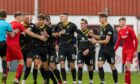 Tempers rise in the Scottish Cup tie between Brora Rangers and Albion Rovers.