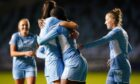 Manchester City's Khadija Shaw celebrates after scoring her side's fifth goal against Leicester.
