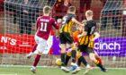 Adam Brown, number 11, puts Stenhousemuir in front against Huntly