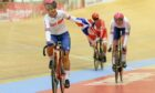Great Britain's Neah Evans, left, and Katie Archibald, right, celebrate after winning the gold medal in the women's Madison race.