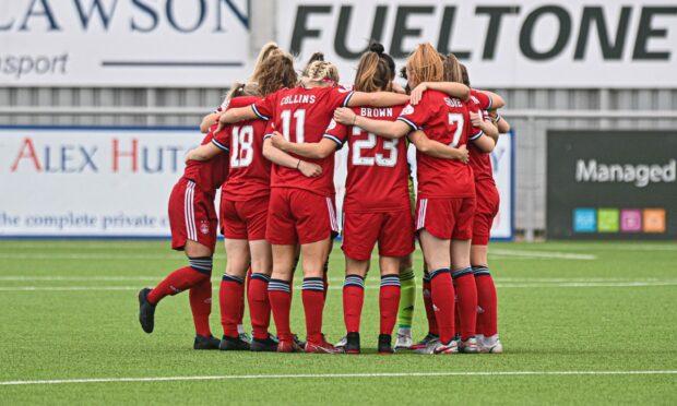 Aberdeen FC Women's team huddle.
