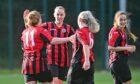 Samantha Louise McDonald (11) celebrates scoring the second goal for Grampian