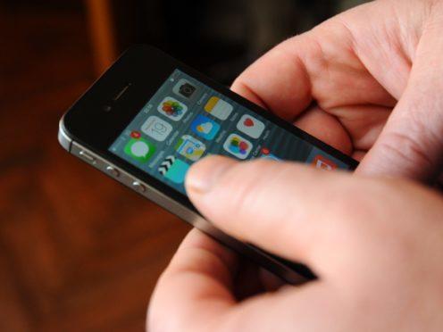 A man using an Apple iPhone (Lauren Hurley/PA)