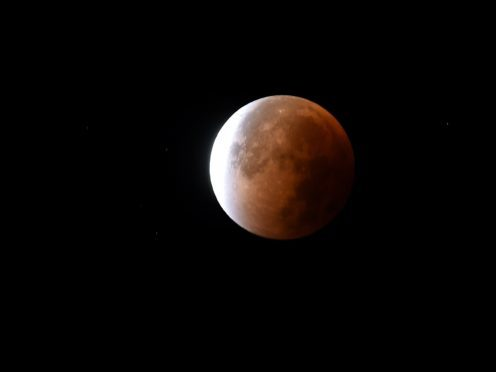 The longest total lunar eclipse of this century is happening this Friday!