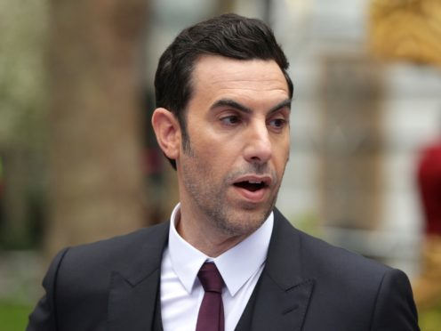 Sacha Baron Cohen Gets Dick Cheney to Sign a 'Waterboarding Kit'