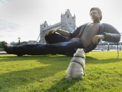 (Doug Peters/PA) EDITORIAL USE ONLY A 25ft statue of Jeff Goldblum's torso in his famous pose from Jurassic Park, which has been created by NOW TV to celebrate the film's 25th birthday is unveiled at Potters Fields Park, London.