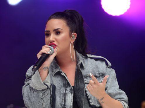 Pop star Demi Lovato taken to hospital following a suspected heroin overdose