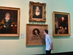A member of staff studies Sir Thomas Laurence's portait of William Wilberforce at the National Portrait Gallery in London (John Stillwell/PA)