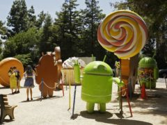 FILE – In this May 18, 2016, file photo, people pose by Android lawn statues at Google's headquarters in Mountain View, Calif. The next version of Google's Android system will be called Pie. It will use artificial intelligence to adapt to how you use the device. (AP Photo/Eric Risberg, File)